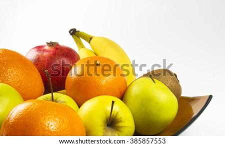 Assortment of exotic fruits on white background - stock photo