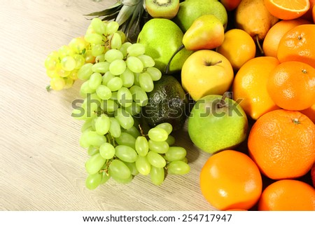 Assortment of exotic fruits on wooden table - stock photo