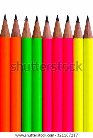 Assortment of fluorescent coloured pencils on white background - stock photo