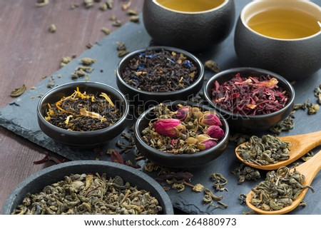 assortment of fragrant dried teas and green tea, close-up, horizontal - stock photo