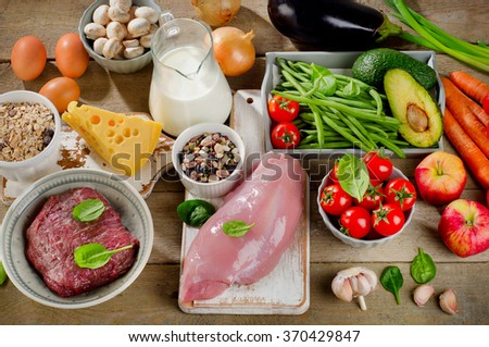 Assortment of Fresh Vegetables and Meats for Healthy Diet on a rustic table. Top view - stock photo