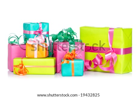 Assortment of gift boxes, reflected on white background. Shallow depth of field - stock photo