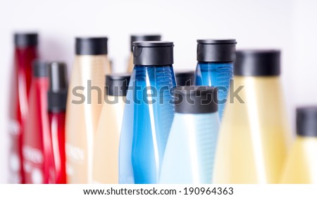 Assortment of hair related products in bottles in hair Salon - stock photo