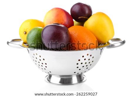 Assortment of juicy fruits isolated on white - stock photo
