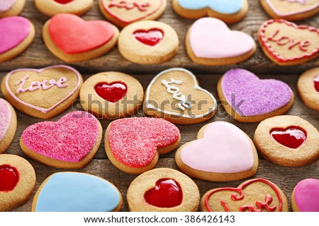 Assortment of love cookies on wooden background, closeup - stock photo