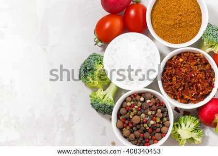 assortment of pepper, salt, spices and fresh vegetables, top view, horizontal - stock photo