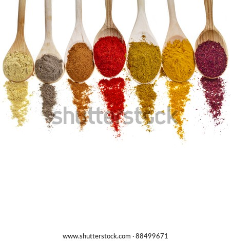 Assortment of powder spices on spoons isolated  on a white background - stock photo