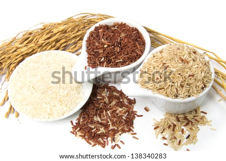 Assortment of rice in white background - stock photo