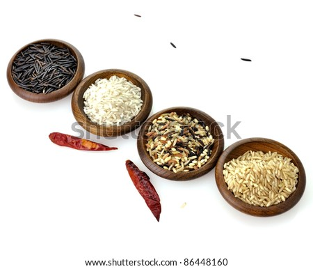 assortment of rice in wooden bowls on white background - stock photo