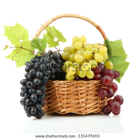 assortment of ripe sweet grapes in basket, isolated on white - stock photo