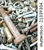 Assortment of rusty metal fasteners. Background for any using in design - stock photo