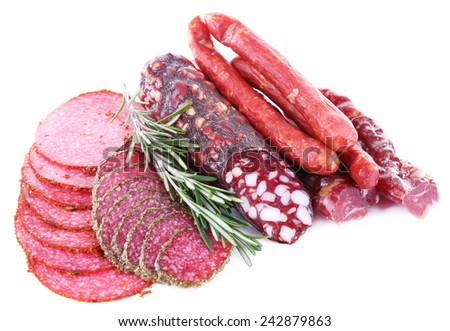 Assortment of smoked sausages isolated on white - stock photo