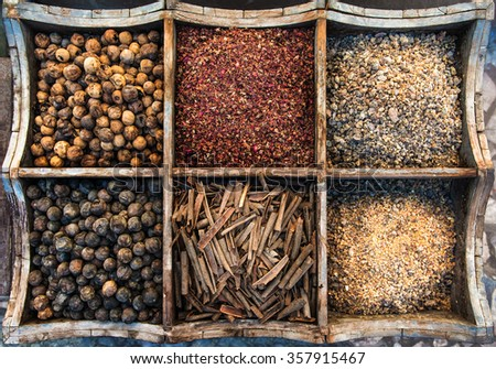 Assortment of spices and olibanum in wooden box. - stock photo