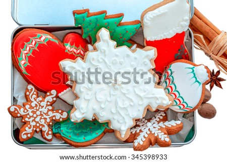 Assortment of spicy decorated Christmas cookies. - stock photo
