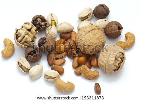 assortment of tasty nuts isolated on white - stock photo