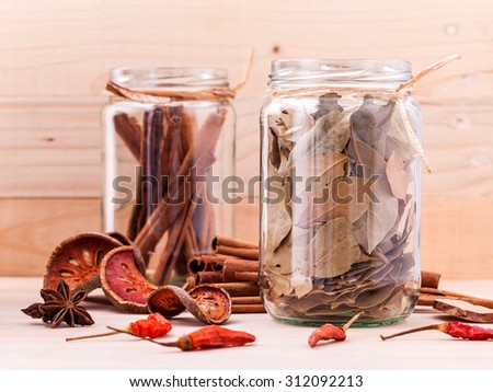 Assortment of Thai food Cooking ingredients in glass bottles on wooden background. - stock photo