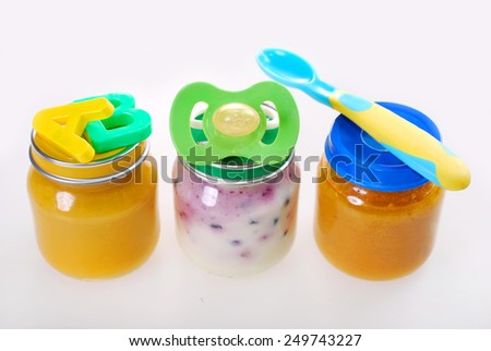 assortment of three baby food in jars  isolated on white - stock photo