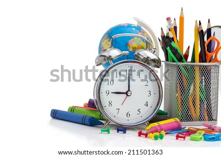 Assortment of various school supplies over white - stock photo