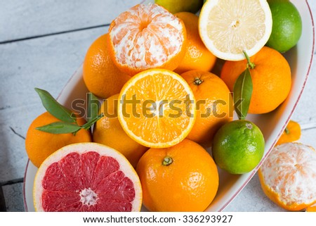Assortment on a tray fresh seasonal fruit acid - stock photo