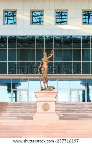 Astana, Kazakhstan - Augusts 18, 2014: located in front of the Supreme Court of the Republic of Kazakhstan - stock photo