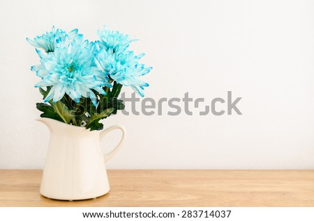 aster flower bouquet on wooden table - stock photo