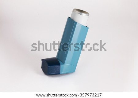 Asthma aerosol inhaler - stock photo