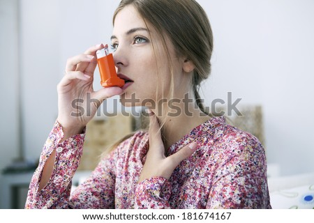 Asthma Treatment, Woman - stock photo