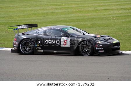 Aston Martin DBR9 on a race track (Phoenix Racing - Delatraz/Piccini) - stock photo