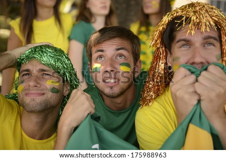 Astonished group of Brazilian sport soccer fans looking at the screen. - stock photo