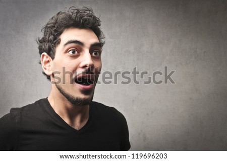 Astonished guy in black - stock photo