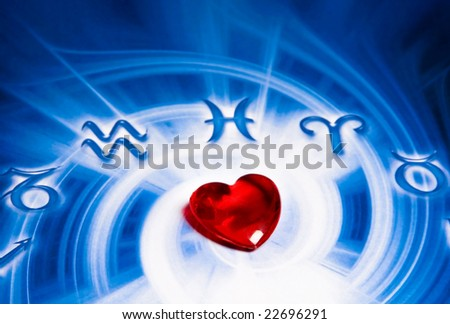 astrological background with a red glass heart shaped in center - stock photo