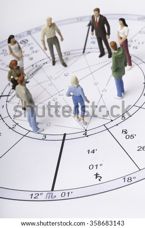 astrology chart with people figurines - stock photo
