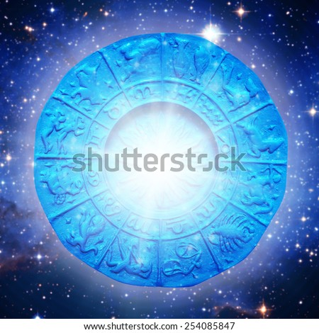 astrology plate with sign symbols and lights effects -  Elements of this image furnished by NASA - stock photo