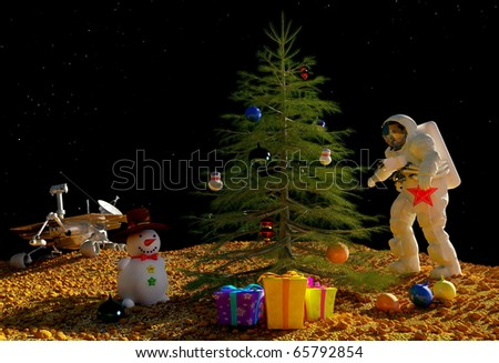 Astronaut dress up a Christmas tree. - stock photo
