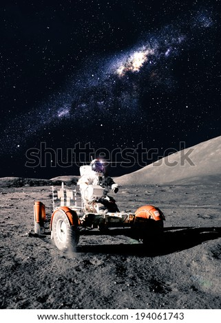 Astronaut Drives Rover. Elements of this image furnished by NASA - stock photo