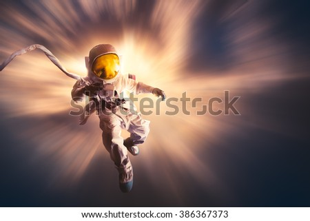 Astronaut floating in the stratosphere - stock photo