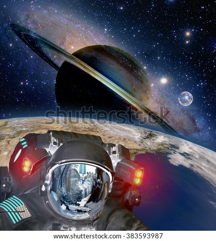 Astronaut helmet et alien extraterrestrial sci fi space earth saturn planet. Elements of this image furnished by NASA. - stock photo