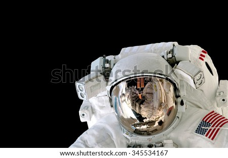 Astronaut helmet isolated on black background spaceman outer space suit. Elements of this image furnished by NASA. - stock photo