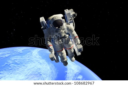 Astronaut in outer space in the chair. - stock photo