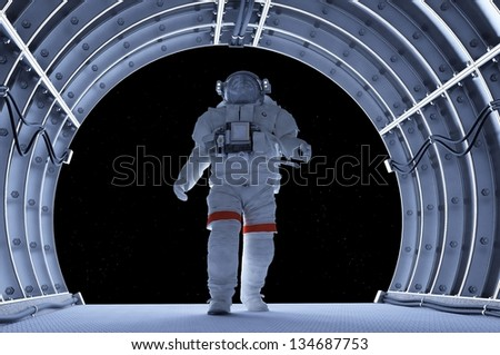 Astronaut in the tunnels of the spacecraft. - stock photo