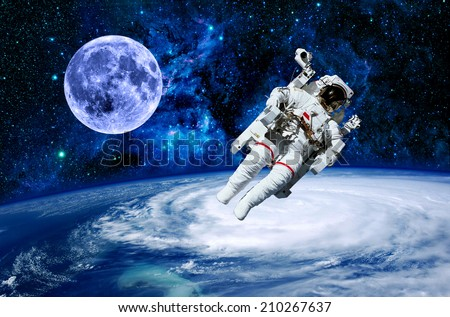 Astronaut moon Earth space starred sky stars. Elements of this image furnished by NASA. - stock photo
