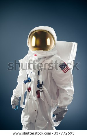 Astronaut on a grey background - stock photo