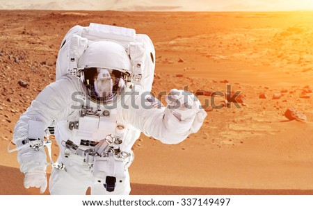 Astronaut on planet mars - Elements of this image furnished by NASA - stock photo