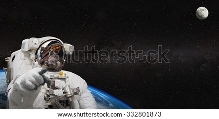 Astronaut on space mission. Elements of this image furnished by NASA. - stock photo