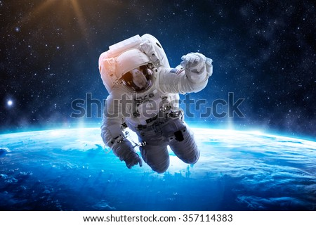 Astronaut Over Earth - Elements of this Image Furnished by NASA - stock photo