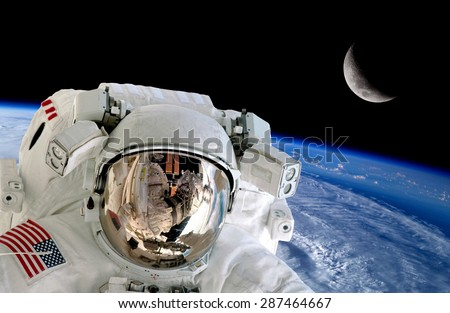 Astronaut spaceman isolated helmet space stunning earth moon. Elements of this image furnished by NASA. - stock photo