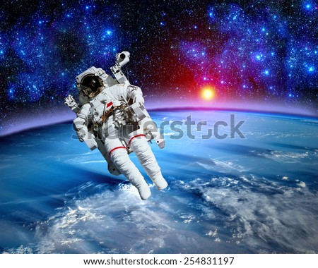 Astronaut spaceman outer space gravity planet earth sun. Elements of this image furnished by NASA. - stock photo