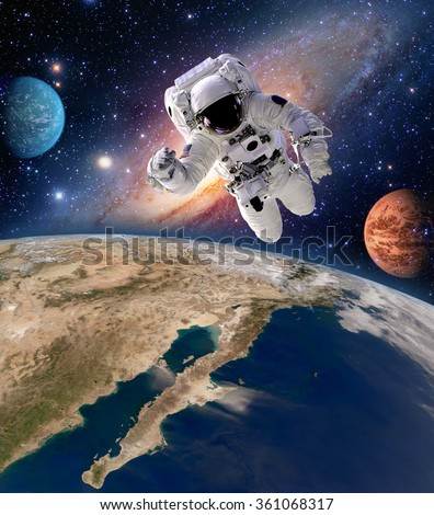 Astronaut spaceman solar system planet spacewalk earth outer space walk galaxy. Elements of this image furnished by NASA. - stock photo