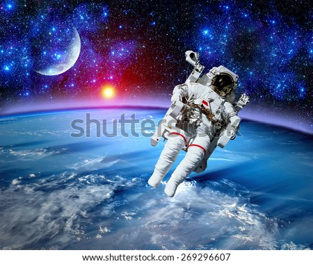 Astronaut spaceman space suit cosmonaut moon earth sun. Elements of this image furnished by NASA. - stock photo