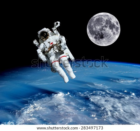 Astronaut spaceman suit earth outer space universe moon. Elements of this image furnished by NASA. - stock photo